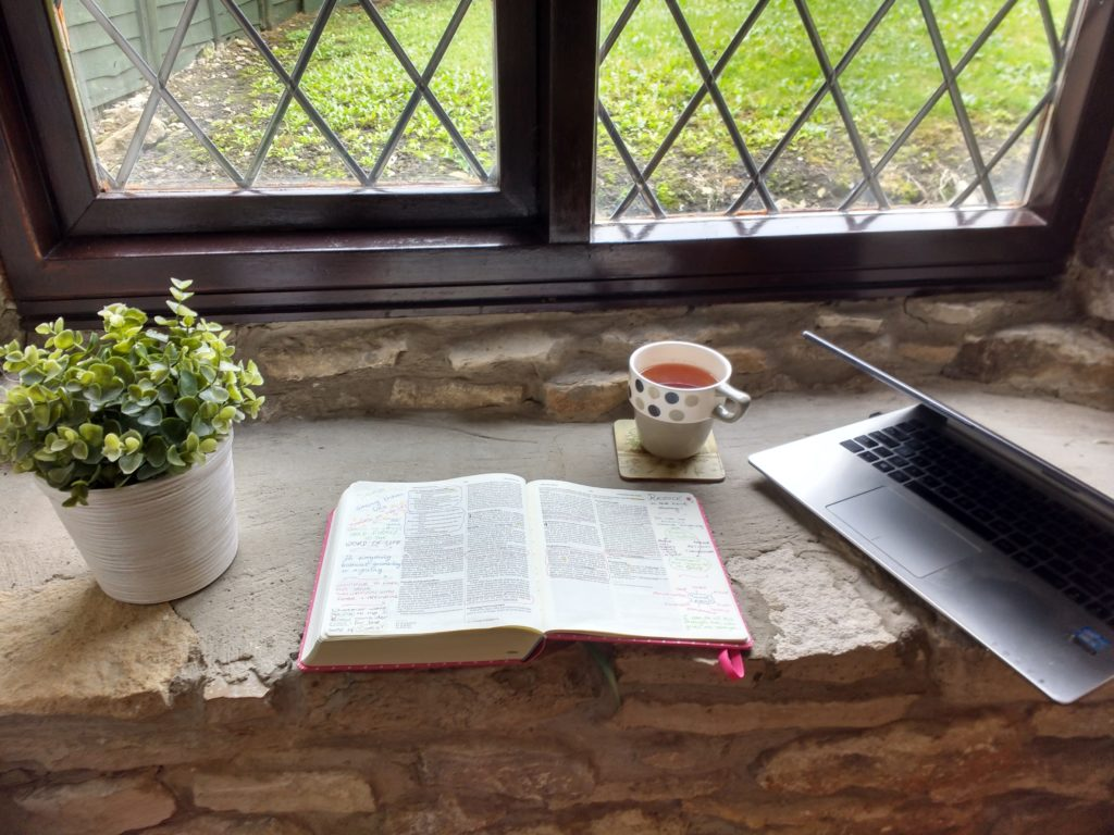 Computer, Bible and Cup of tea in my writing cottage.